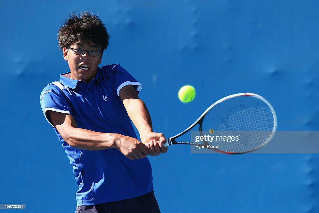 Hyeon Chung of Korea plays a handhand in his first round match against Jake Delaney of Australia during the 2013 Australian Open Junior Championships at Melbourne Park on January 19, 2013 in Melbourne, Australia.