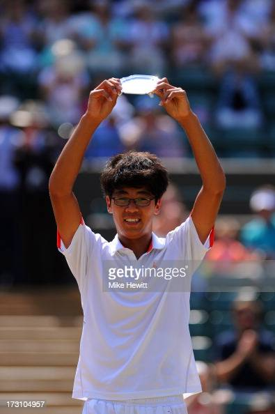 Hyeon Chung of Korea poses with his runnerup trophy after the Boys' Singles Final match against Gianluigi Quinzi of Italy on day thirteen of the...
