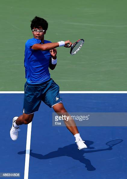 Hyeon Chung of Korea returns a shot against Stan Wawrinka of Switzerland during their Men's Singles Second Round match on Day Four of the 2015 US...