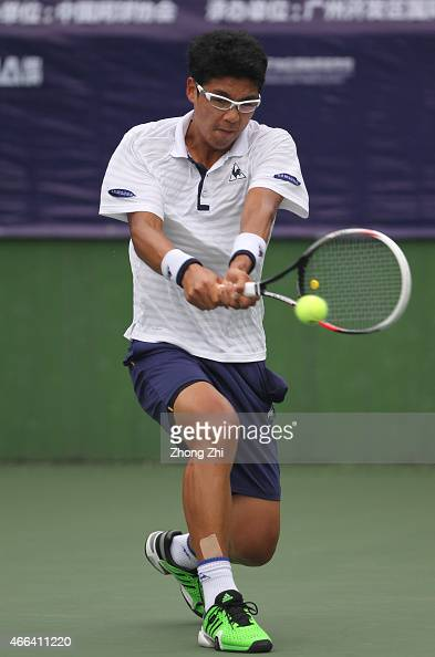Hyeon Chung of Korea returns a shot during his match against Roberto Carballes Baena of Spain during the ATP Challenger Guangzhou Tour Day 5 at...