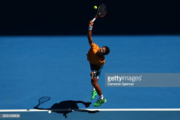 Hyeon Chung of Korea serves in his first round match against Novak Djokovic of Serbia during day one of the 2016 Australian Open at Melbourne Park on...