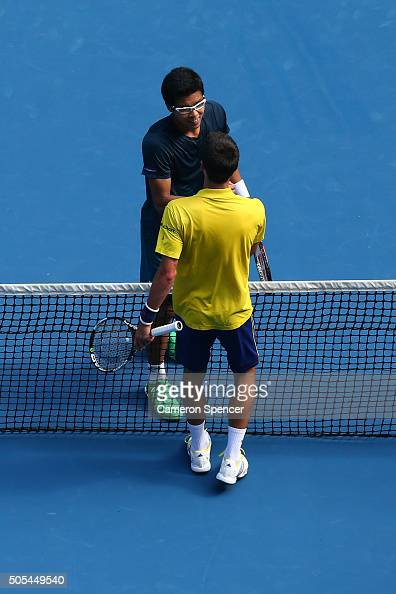 Hyeon Chung of Korea shakes hands with Novak Djokovic of Serbia after their first round match during day one of the 2016 Australian Open at Melbourne...