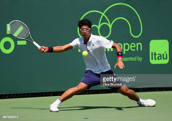 Hyeon Chung of Korea stretches to play a forehand against Marcel Granollers of Spain in their first round match during the Miami Open at Crandon Park...