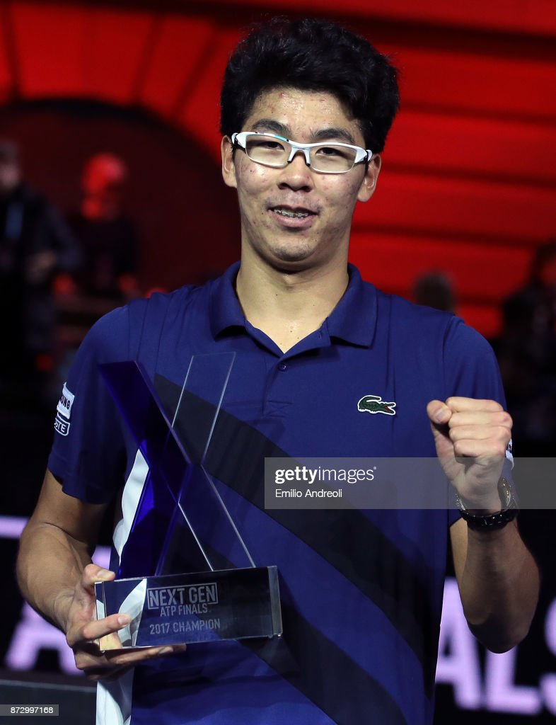 Hyeon Chung of South Korea celebrates with the trophy after victory against Andrey Rublev of Russia in the mens final on day 5 of the Next Gen ATP Finals on November 11, 2017 in Milan, Italy.