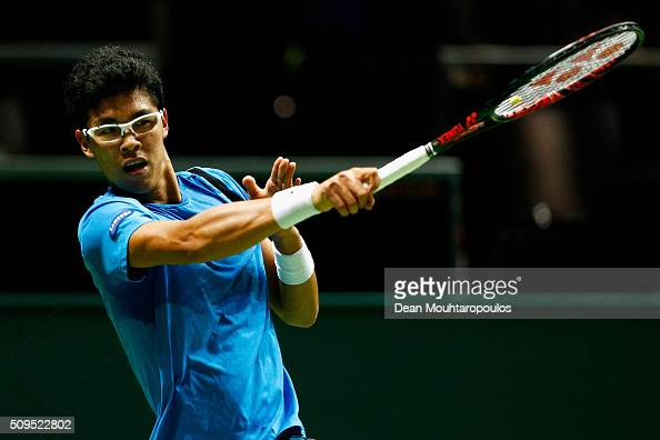 Hyeon Chung of South Korea in action against Viktor Troicki of Serbia during day 4 of the ABN AMRO World Tennis Tournament held at Ahoy Rotterdam on...