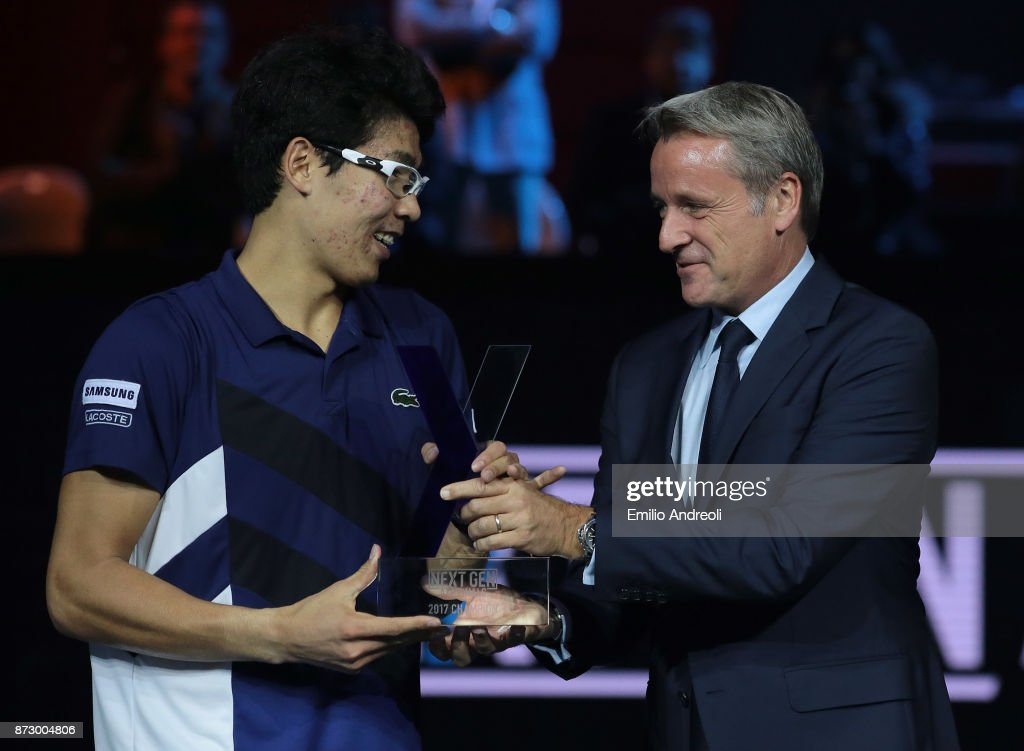 Hyeon Chung of South Korea (L) is rewarded by ATP World Tour Executive Chairman and President Chris Kermode at the end of the mens final on day 5 of the Next Gen ATP Finals on November 11, 2017 in Milan, Italy.