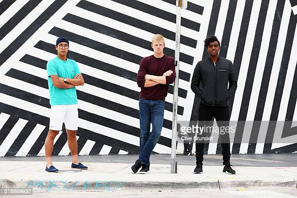 Hyeon Chung of South Korea Kyle Edmund of Great Britain and Elias Ymer of Sweden all pose for a photograph at the Wynwood Walls in Miami prior to the...