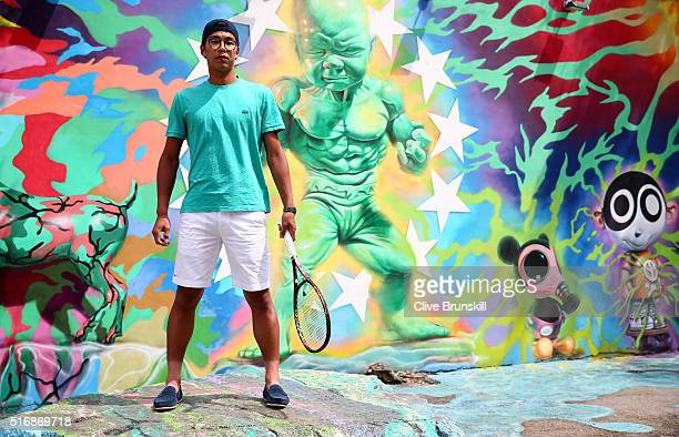 Hyeon Chung of South Korea poses for a photograph at the Wynwood Walls in Miami prior to the Miami Open Presented by Itau at Crandon Park Tennis...