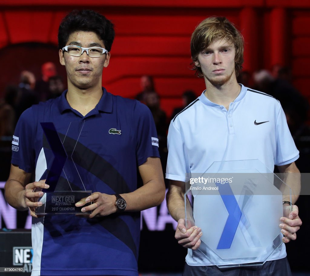 Hyeon Chung of South Korea (L) poses with the trophy with Andrey Rublev of Russia after victory the mens final on day 5 of the Next Gen ATP Finals on November 11, 2017 in Milan, Italy.