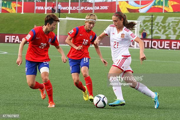Hyeri Kim and Yumi Kang of Korea Republic defend against Alexia Putellas of Spain during the FIFA Women's World Cup Canada 2015 Group E match between...