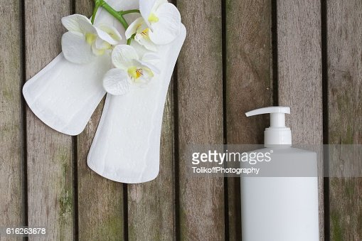 Hygiene items of a woman on a wooden surface. Background : Stock Photo