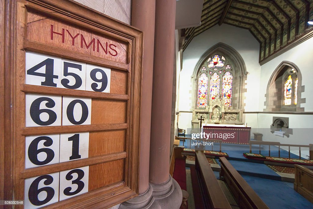 Hymn numbers posted on a wooden board in st. andrew's church; kelso scottish borders scotland