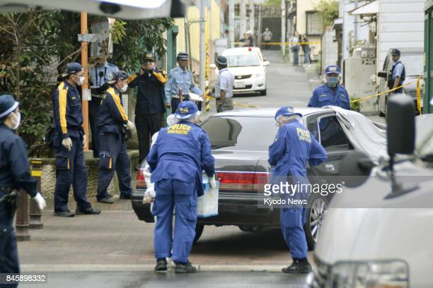 Hyogo prefectural police work in a residential area of Kobe on Sept 12 where a man believed to be a bodyguard of the head of a splinter gang group...