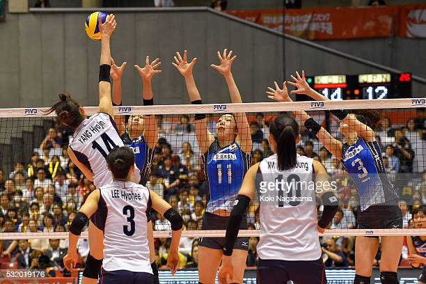 HyoJin Yang of Japan spikes the ball during the Women's World Olympic Qualification game between South Korea and Japan at Tokyo Metropolitan...