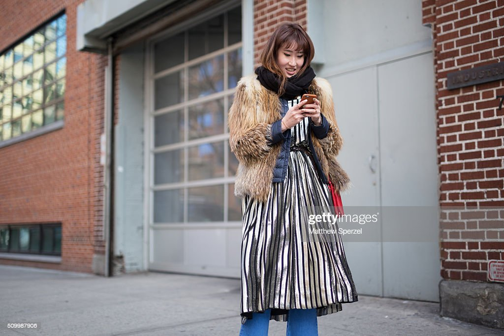 Hyojung Uyoo is seen at Jill Stuart wearing a Mcginn fur coat, Jill Stuart dress, Korean national brand shoes, Stella Mccartney pants, and Celine bag during New York Fashion Week: Women's Fall/Winter 2016 on February 13, 2016 in New York City.