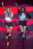 Hyolyn and Bora of South Korean girl group SISTAR perform onstage during their new album 'Touch and Move' showcase at Ilchi Art Hall on July 21 2014...