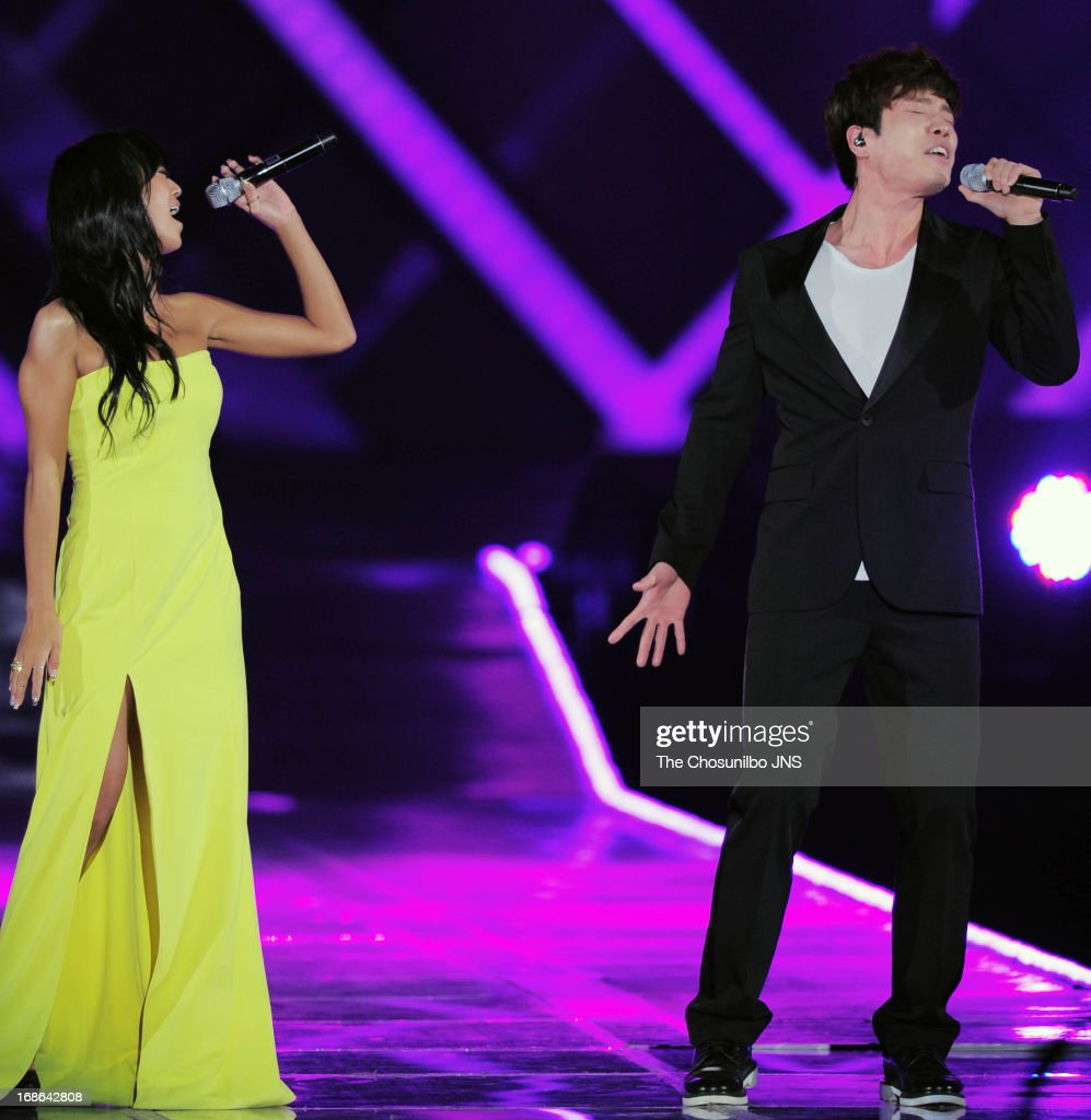 HyoLyn of Sistar and ChangMin of 2am perform onstage during 'Dream Concert 2013' at Sangam Worldcup Stadium on May 11 2013 in Seoul South Korea