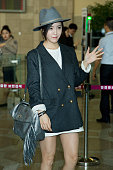 Hyomin of South Korean girl group Tara is seen on departure at Gimpo International Airport on October 13 2014 in Seoul South Korea