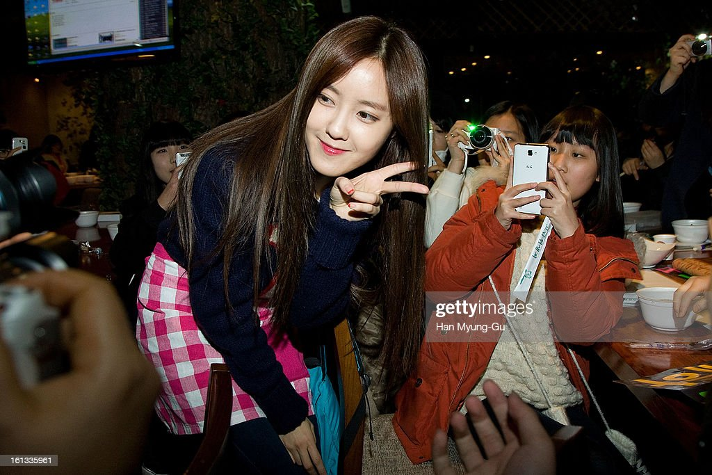 Hyomin (Hyo-Min) of South Korean girl group T-ara surrounded by fans at the Core Contents Media Artists New Year's Day Charity Event at Gibalhan Chicken Store on February 9, 2013 in Bucheon, South Korea.