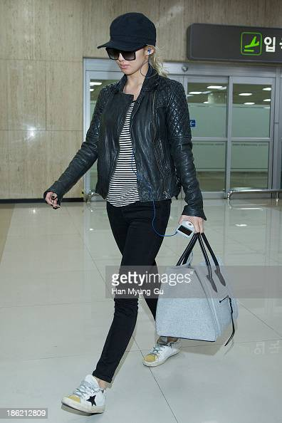 Hyoyeon of South Korean girl group Girls' Generation is seen upon arrival at the Gimpo Airport on October 28 2013 in Seoul South Korea