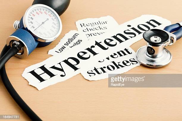 Überschrift bei Bluthochdruck Blutdruck gage und Stethoskop