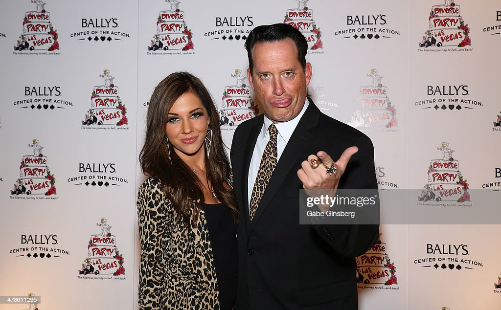 Hypnotist Anthony Cools (R) jokes around with Morea Reveen as they arrive at the Las Vegas premiere of 'Divorce Party' at the Windows Showroom at Bally's Las Vegas on March 13, 2014 in Las Vegas, Nevada.