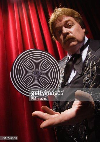 Hypnotist trick. : Stock Photo