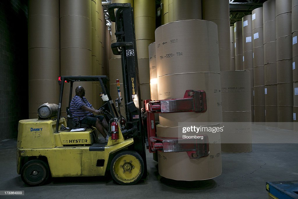 A Hyster Co. truck moves newsprint rolls at the Washington Post newspaper production facility in Springfield, Virginia, U.S., on Friday, July 12, 2013. The Washington Post began publishing on Thursday, Dec. 6, 1877, and had a circulation of 10,000. The newspaper contained four pages and cost three cents a copy. Photographer: Andrew Harrer/Bloomberg via Getty Images
