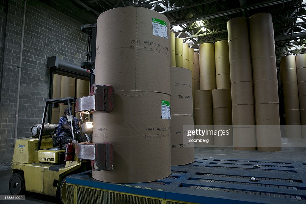 A Hyster Co. truck moves newsprint rolls onto a conveyor at the Washington Post newspaper production facility in Springfield, Virginia, U.S., on Friday, July 12, 2013. The Washington Post began publishing on Thursday, Dec. 6, 1877, and had a circulation of 10,000. The newspaper contained four pages and cost three cents a copy. Photographer: Andrew Harrer/Bloomberg via Getty Images