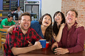 Young group of hipsters laughing hysterically