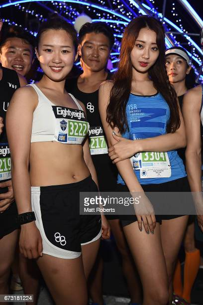 Hyun Kyung Na and Kyungri Park of Korea pose for a photograph during the United Airlines Guam Marathon 2017 on April 9 2017 in Guam Guam