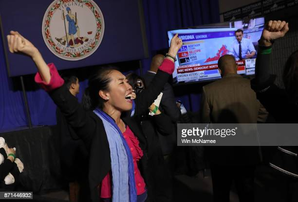 Hyun Lee a supporter of Ralph Northam the Democratic candidate for governor of Virginia celebrates as early projections indicated a Northam victory...