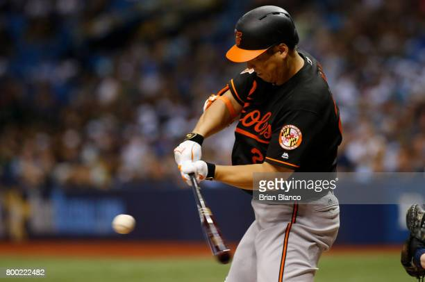 Hyun Soo Kim of the Baltimore Orioles grounds out to third baseman Evan Longoria of the Tampa Bay Rays to end the top of the sixth inning of a game...