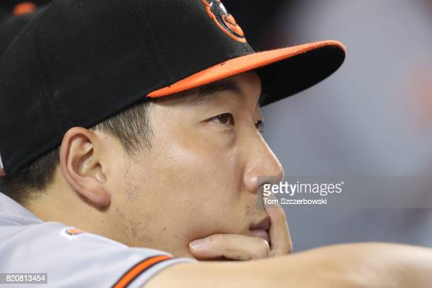Hyun Soo Kim of the Baltimore Orioles looks on from the top step of the dugout during MLB game action against the Toronto Blue Jays at Rogers Centre...