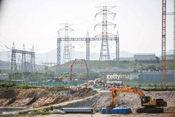 A Hyundai Construction Equipment Inc excavator stands at the temporarily suspended construction site of the Shin Kori No 5 and 6 nuclear power...
