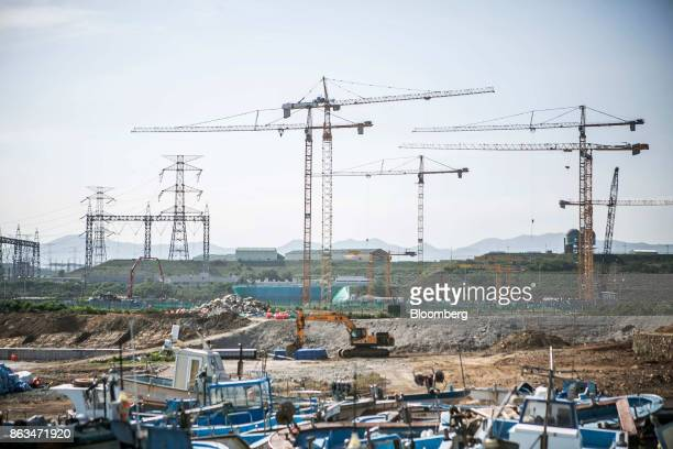A Hyundai Construction Equipment Inc excavator stands at the temporary suspended construction site of Shin Kori fifth and sixth nuclear power...