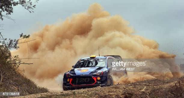 TOPSHOT Hyundai driver Andreas Mikkelsen of Norway powers through a corner on the first day of World Rally Championship event Rally Australia near...