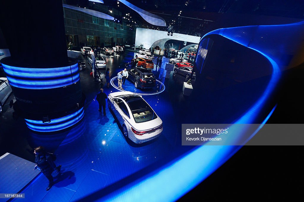 Hyundai Motor Co. cars seen through a screen are displayed during the Los Angeles Auto show on November 29, 2012 in Los Angeles, California. The LA Auto Show opens to the public on November 30 and runs through December 9.
