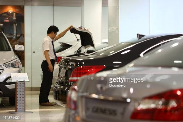 A Hyundai Motor Co employee inspects the trunk of a Sonata sedan at one of the company's dealerships in Seoul South Korea on Wednesday July 24 2013...