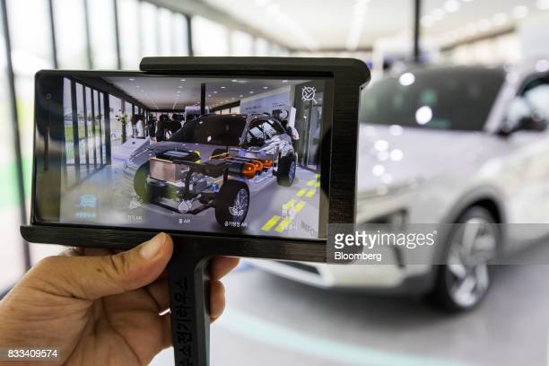 A Hyundai Motor Co next generation fuelcell electric sport utility vehicle powertrain system is seen on an augmented reality monitor during an...