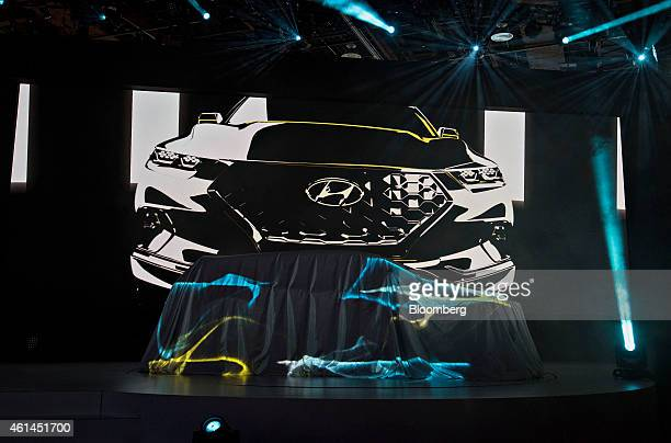 A Hyundai Motor Co Santa Cruz crossover truck concept vehicle sits under a sheet prior to its unveiling during the 2015 North American International...