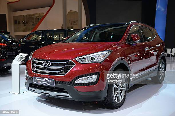 A Hyundai Motor Co Santa Fe vehicle stands on display at the Gaikindo Indonesia International Auto Show in Jakarta Indonesia on Friday Aug 21 2015...