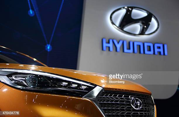 A Hyundai Motor Co Tucson sports utility vehicle stands on display at the 16th Shanghai International Automobile Industry Exhibition in Shanghai...