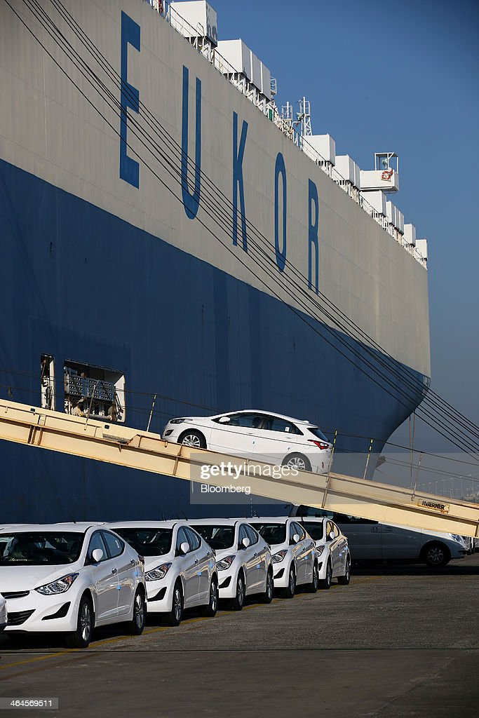A Hyundai Motor Co vehicle bound for export is driven into a Eukor Car Carriers Inc rollon/rolloff cargo ship at a port near the company's plant in...