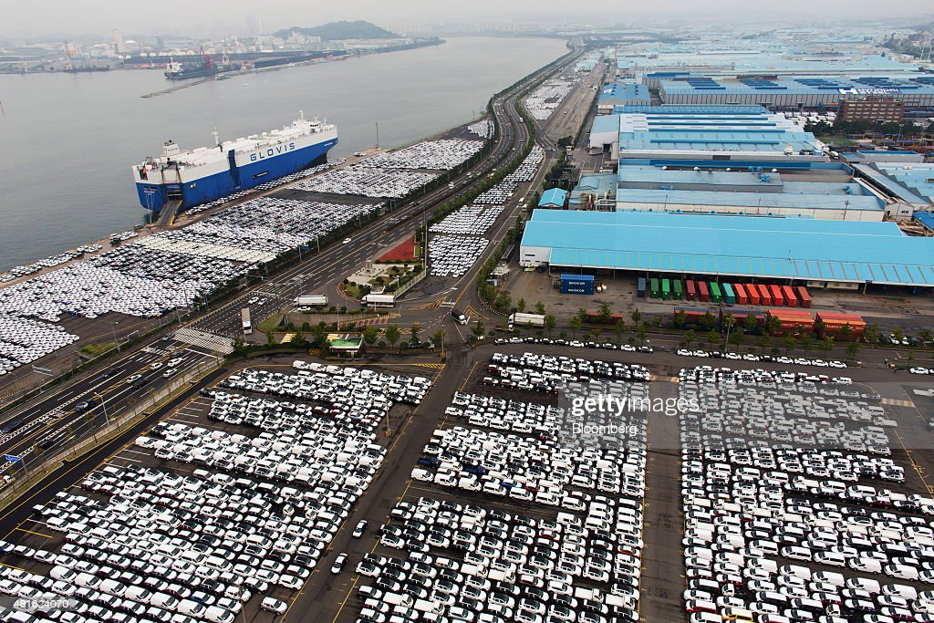 Hyundai Motor Co vehicles bound for export await shipment at a port near the company's Ulsan plant in this aerial photograph in Ulsan South Korea on...