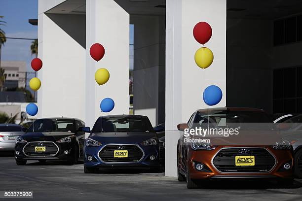 Hyundai Motor Co Veloster compact vehicles sit on display for sale on the lot of the Keyes Hyundai dealership in the Van Nuys neighborhood of Los...