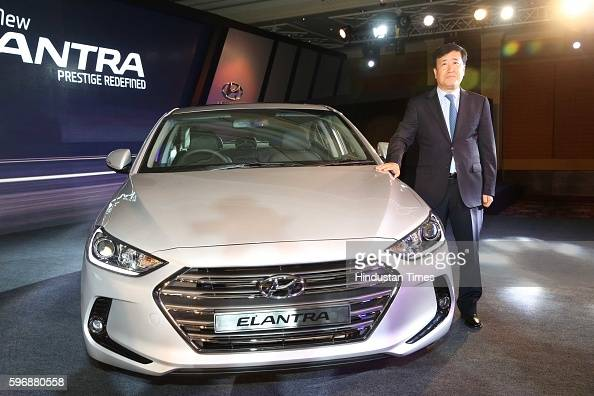 Hyundai motor india md and ceo yk koo poses during the launch of new