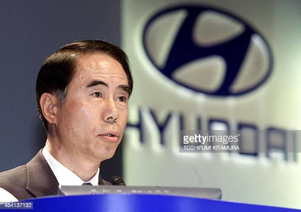 Hyundai Motors Japan President Kim JinSu speaks to journalists at a hotel in Tokyo 25 October 2000 where he announced the company will put three...