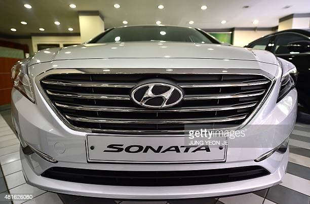 Hyundai Motor's sedan Sonata is displayed at a branch in Seoul on July 23 2015 Hyundai Motor Co said on July 23 its secondquarter net profit plunged...