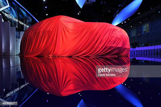 Hyundai remains covered prior to its unveiling during media preview days at the 2013 Los Angeles Auto Show on November 20 2013 in Los Angeles...